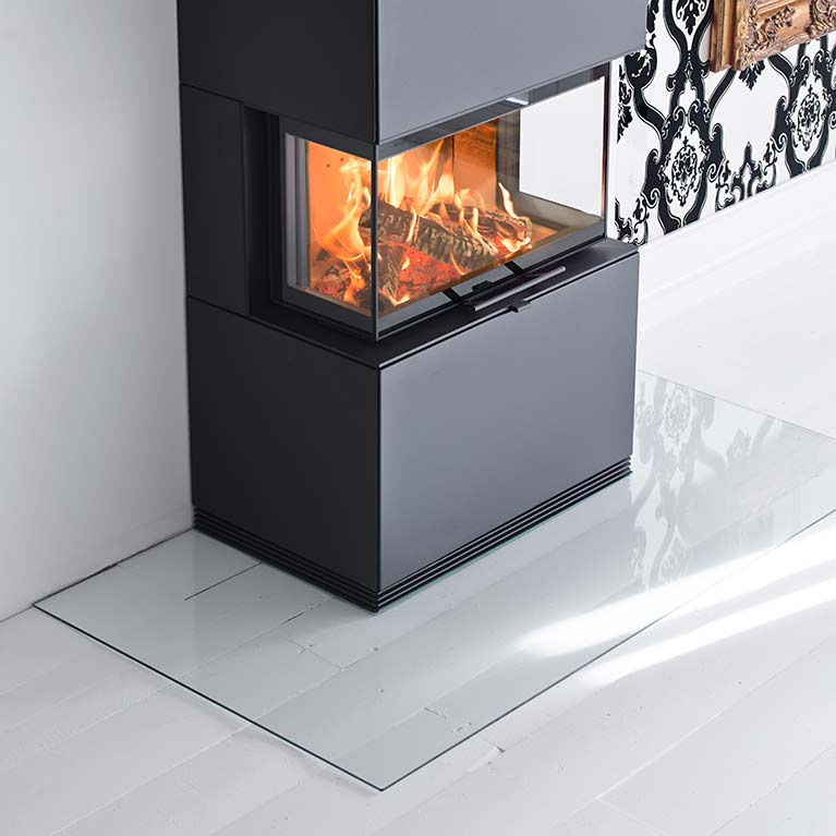 Angled floor protector for wood burning stoves