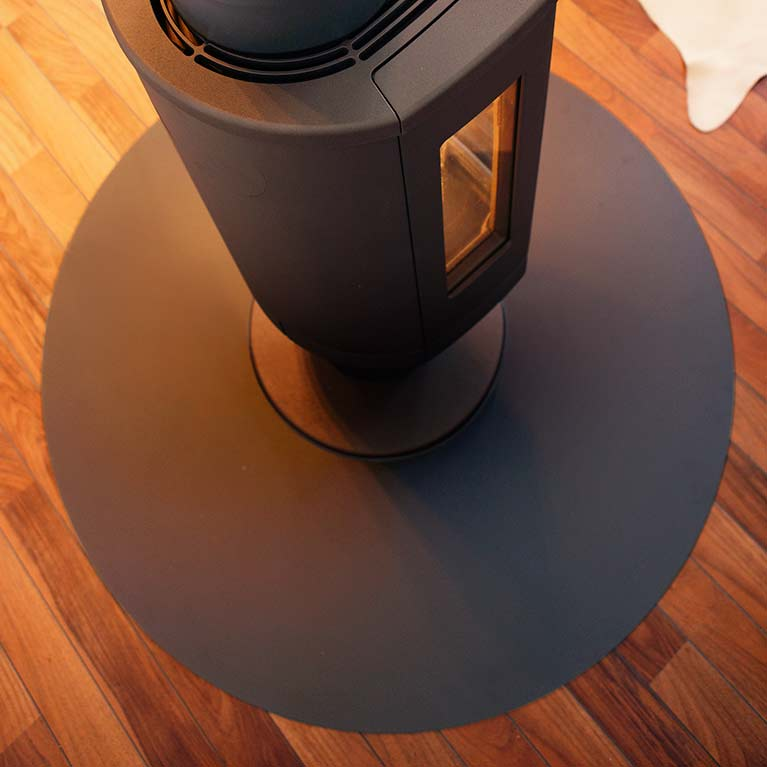 Circular shaped floor protector for wood burning stoves