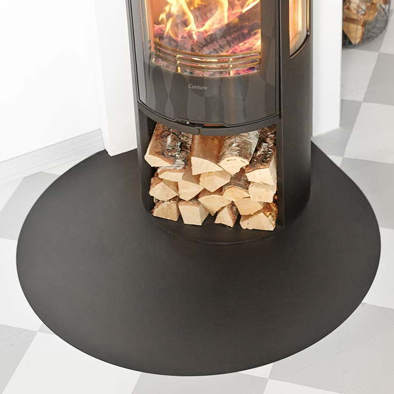 Ellipse-shaped floor protector for wood burning stoves